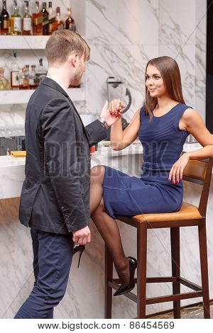 Man gives a hand to his couple