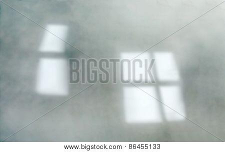 De-focused green wall, window reflections