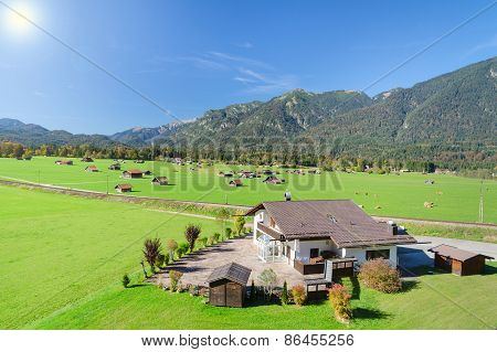 Alpine Mountains Summer Green Meadow In Valley Landscape