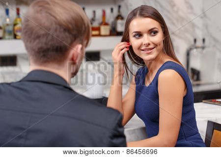 Couple has a drink in the bar