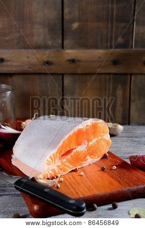 Fresh Raw Salmon Steak Slices On The Board