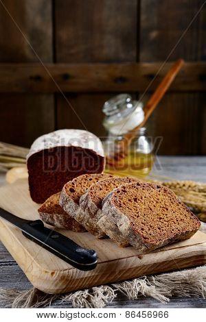 Black Sliced Bread On A Cutting Board
