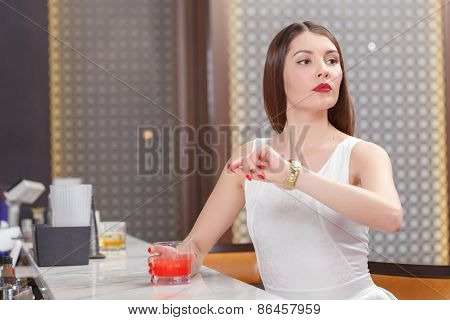 Woman looks at her watch