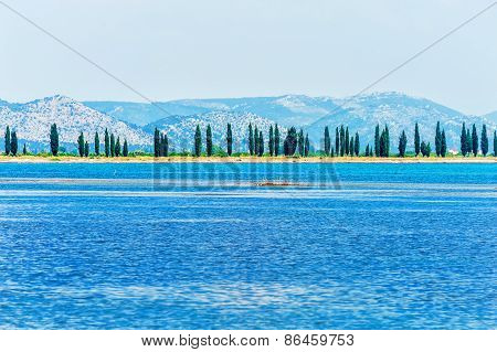 A Peaceful Scene From Croatian Coast On The Adriatic Sea With Pine Trees In Distance