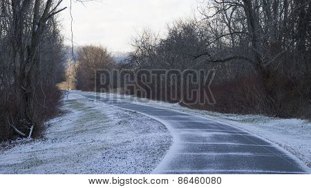 Paved Winding Trail Dusted with Snow.