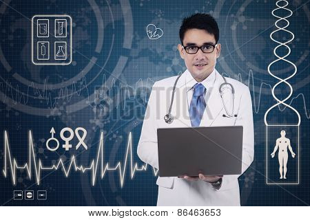 Doctor Holding A Laptop