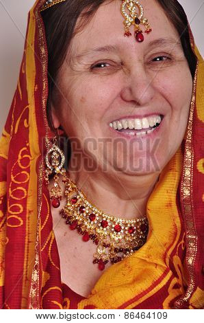 Happy Laughing Senior Woman In Traditional Indian Clothing And Jeweleries