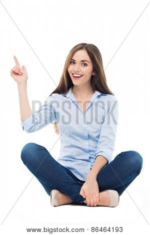 Young woman sitting and pointing