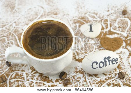 Cup Of Coffee With Rocks Saying