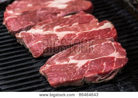 Fresh beef steaks on grill
