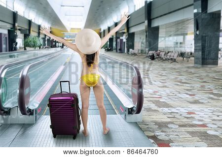 Happy Woman Wearing Bikini In Airport Hall 1
