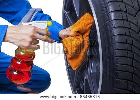 Mechanic Cleaning A Tire Rim
