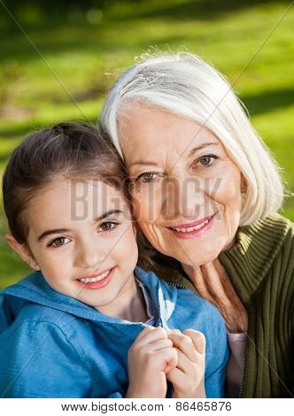 Portrait of smiling girl with grandmother at campsite