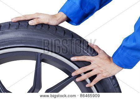 Mechanic Hands Replace A Tire