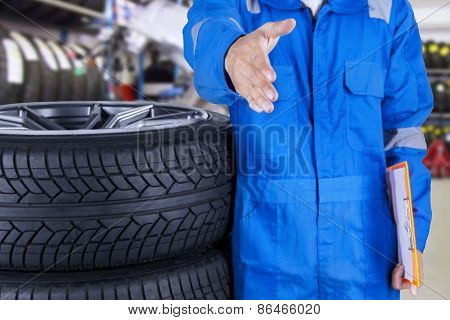 Mechanic Offering Handshake