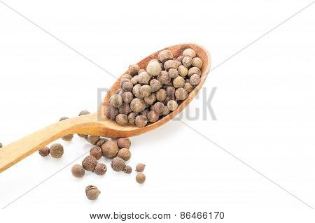 A Lot Of Allspice On Wooden Spoon. Isolated