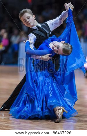 Minsk, Belarus -february 14, 2015: Unidentified Professional Dance Couple Performs Juvenile-1 Standa