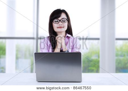 Young Businesswoman Praying At Office 1