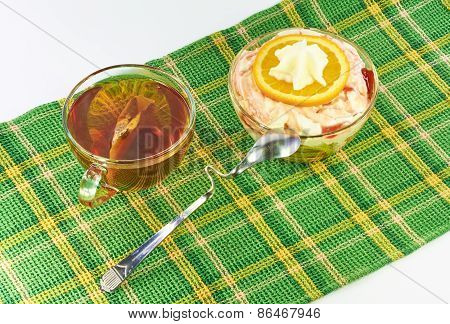 Tea And Milk Dessert With Oranges On A Napkin
