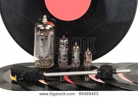 Vintage vacuum tubes with vinyl record