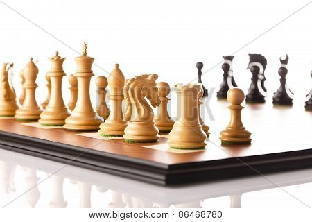 Chess pieces setup before the game - black and white chess pieces standing on a chessboard