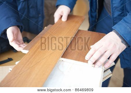 wood floor parquet shop selecting variants hands closeup