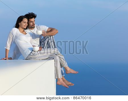 happy young romantic couple have fun relax smile at modern home outdoor terace balcony terace
