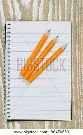 Pencils And Paper On Top Of Desktop