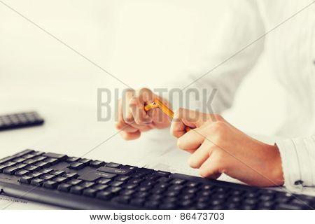 business, stress, problem concept - woman breaking pencil