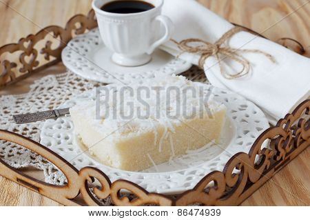 Brazilian  Dessert: Sweet Couscous  Pudding With Coconut, Cup Of Coffee On Tray