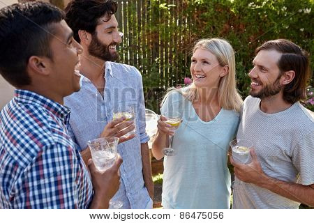 friends outdoors at garden party gathering with cocktail wine drinks