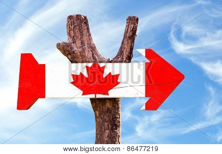 Canada wooden sign with sky background