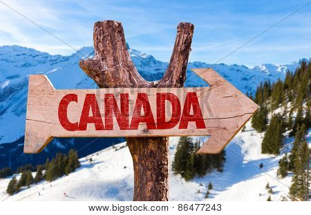 Canada wooden sign with alps background
