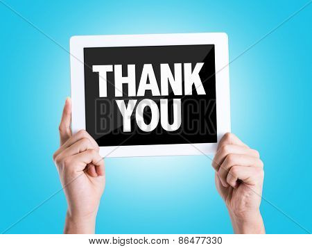 Tablet pc with text Thank You with blue background