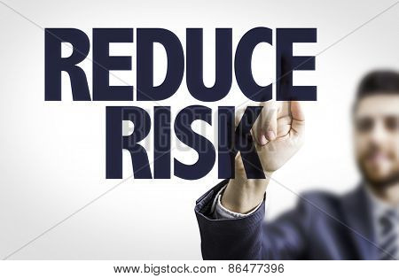 Business man pointing the text: Reduce Risk