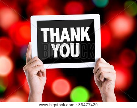 Tablet pc with text Thank You with bokeh background