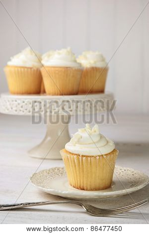 Sweet vanilla cupcakes ready to eat