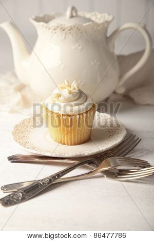 Sweet vanilla cupcake ready to eat