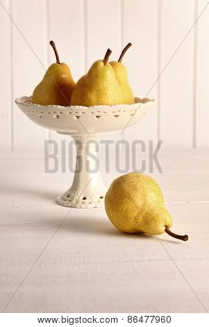 Still life of pears in fruit bowl on table