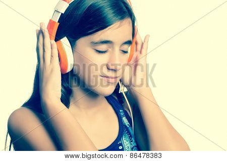 Instagram toned small teenage girl listening to music on her headphones