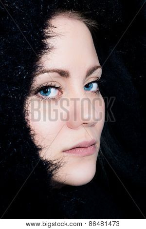 Young Woman In Semi Profile With A Black Hood