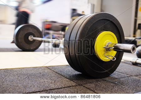 Closeup barbell plates isolated on a white background.
