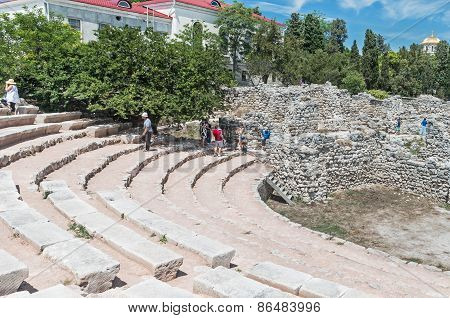 Tourists Ancient Amphitheater In Chersonesos