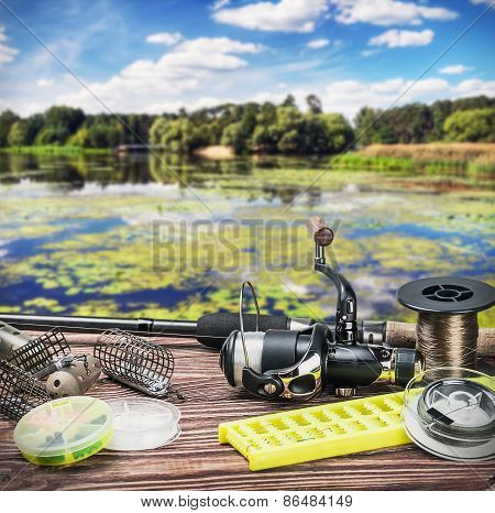 Fishing Tackle On A Wooden Float On A Background Of Forest Lake