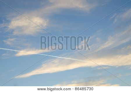 Sky With Dramatic Clouds And Vapor Trails