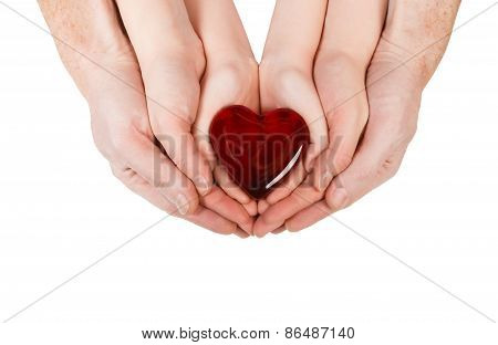 Family Concept - Parents' Hands Holding Child Hands With Heart