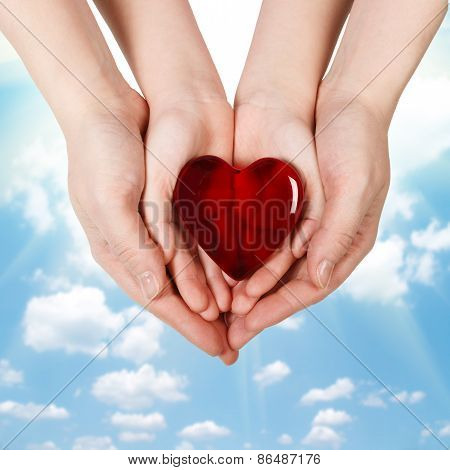 Family Concept - Mother's Hands Holding Child Hands With Heart