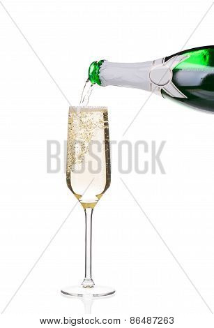 Champagne pouring in a glass.