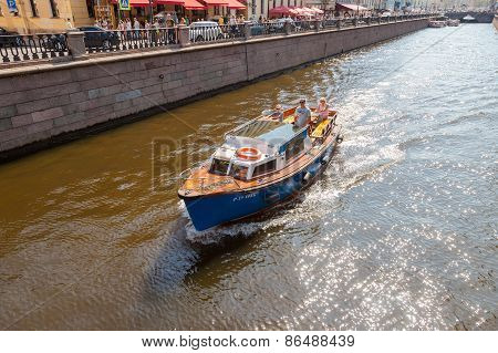 Tourist Boat Goes Through The Channel On A Sunny Day In The Historic City Of Petersburg, Russia