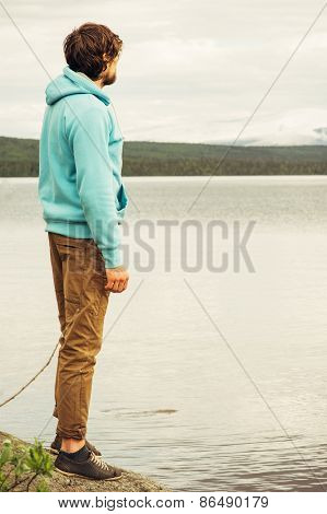Man Traveler walking alone outdoor Lifestyle Travel concept